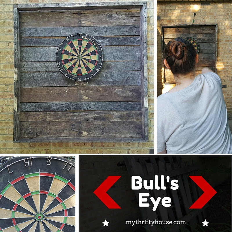 Enjoying a quick game using the outdoor dartboard made from pallets.
