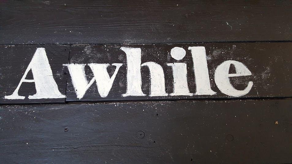 Filling in the chair bench saying with chalkpaint