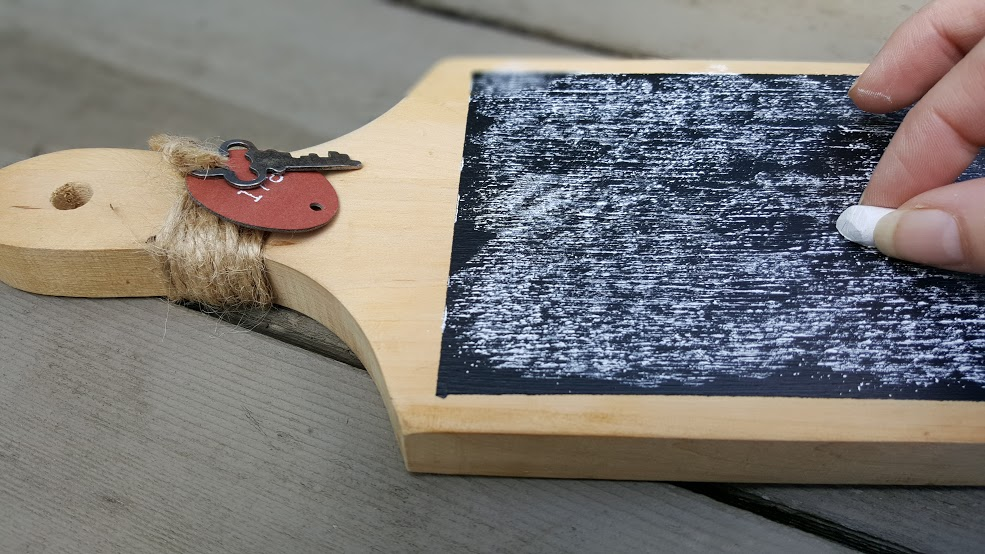 Priming the chalkboard cheese platter with some chalk