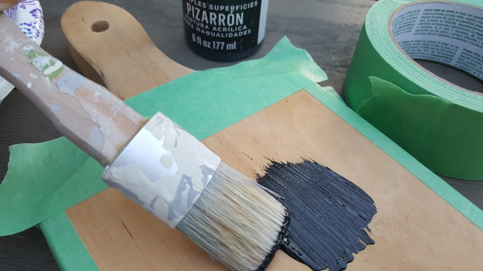 Tape of the edges of the cutting board and add one coat of chalkboard paint