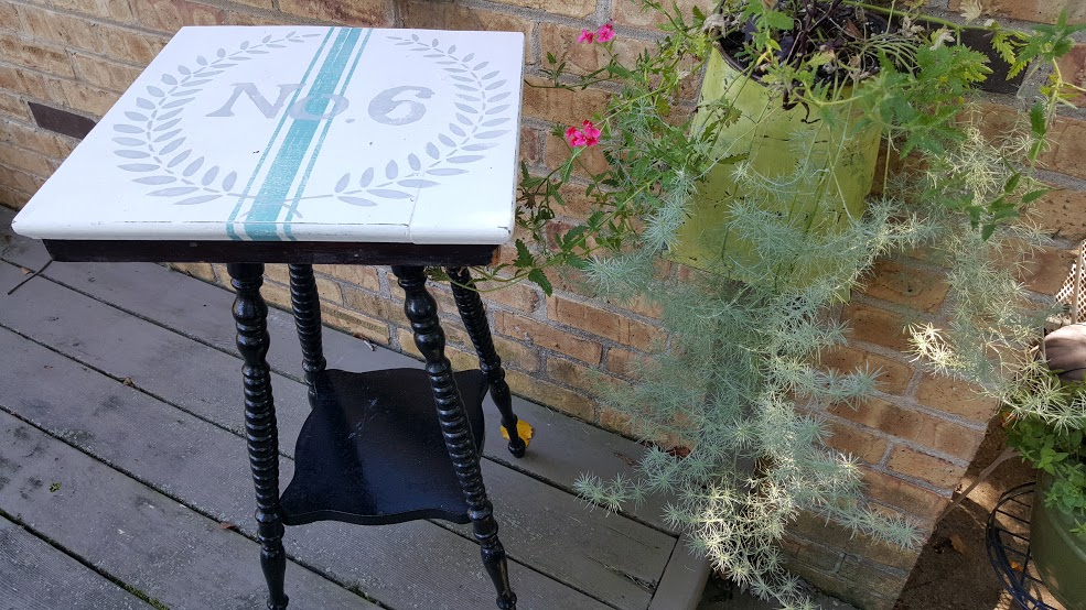 spindle leg table with stenciled grain sack top