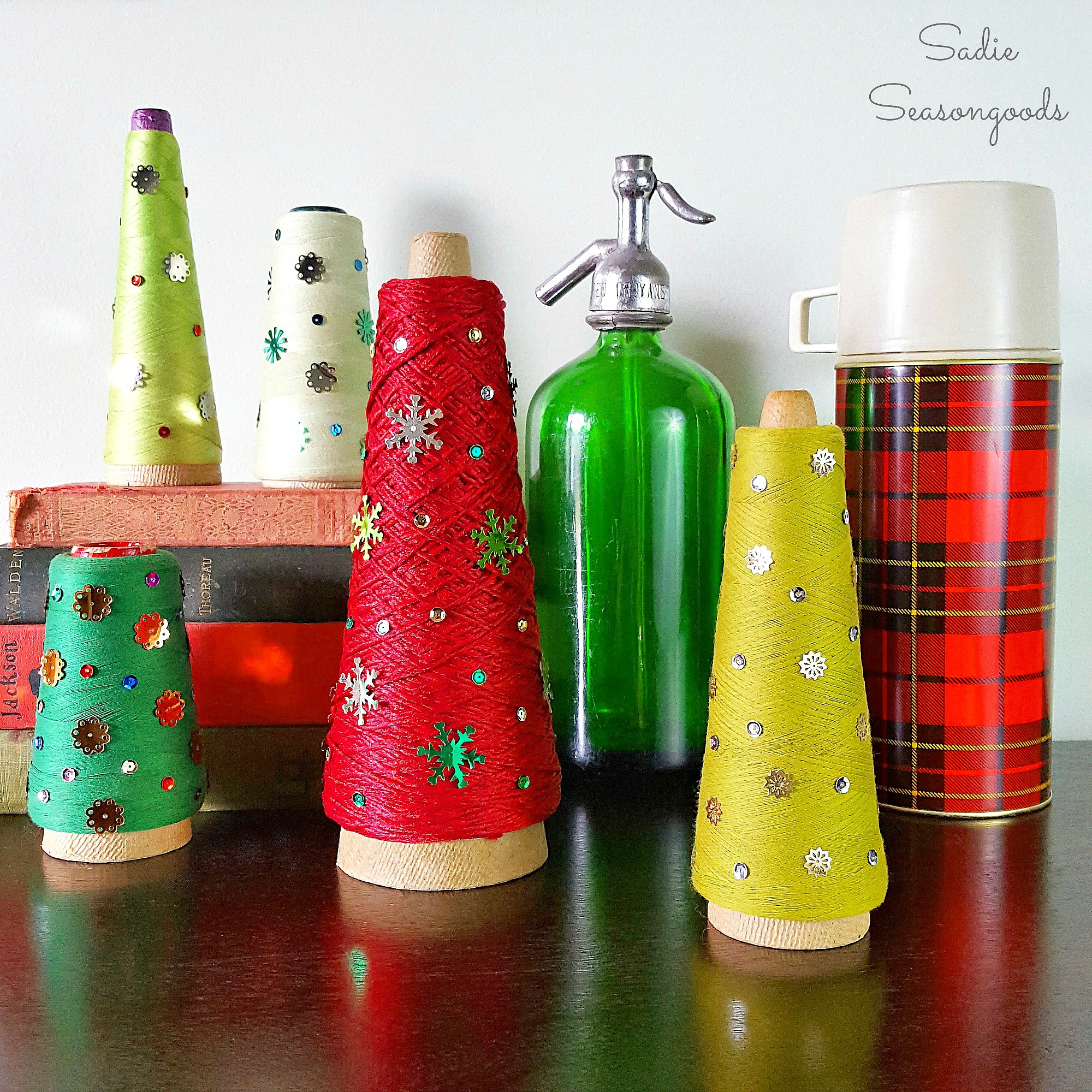 waste-not-wednesday-week-27-vintage_serger_cone_thread_repurposed_and_upcycled_as_diy_christmas_trees_with_vintage_sequins_holiday_decor_by_sadie_seasongoods