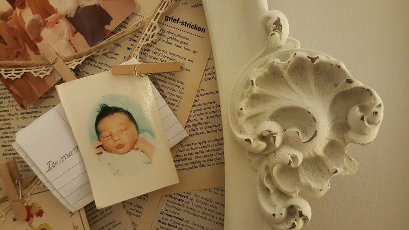 Grief stricken definition and keepsakes hanging on my Book Page Memo Board