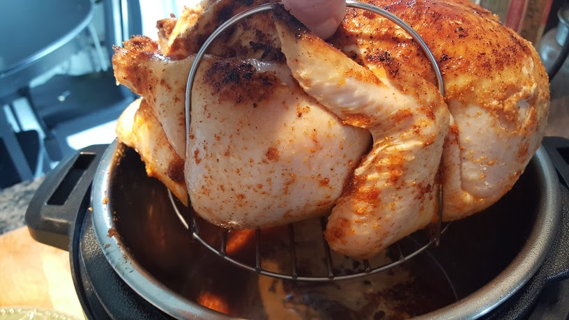 Whole30 Roasted Chicken is easier to take out of the pot with the metal trivot but is optional.