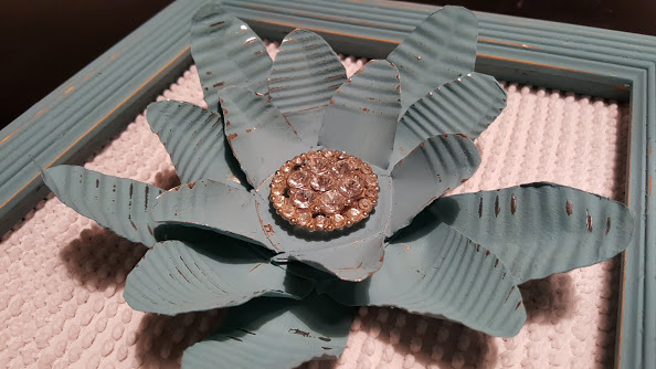 Painted metal flower made from 3 tin cans