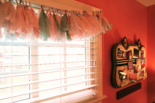 teenage girl bedroom makeover with tassel garland window treatments