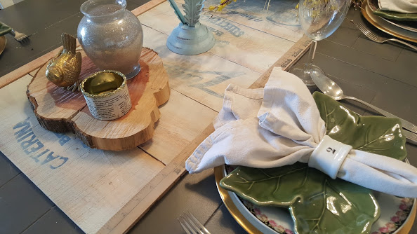 simple and elegant table setting with cloth napkins and mismatched dishes