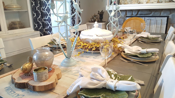 elegant and simple table setting with metal bird candle holders
