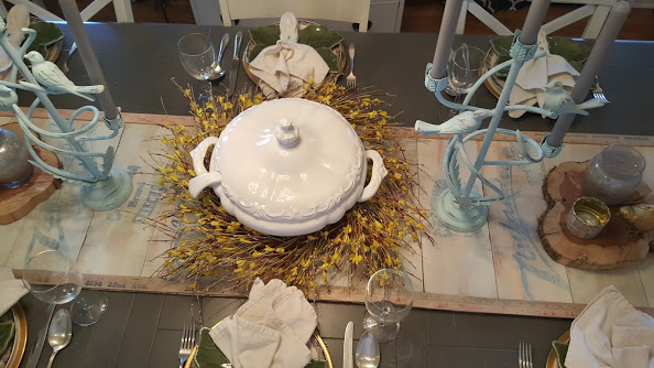 wooden farmhouse table runner with nature themed place settings